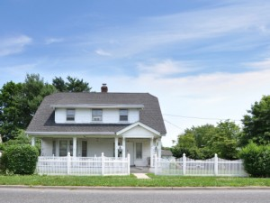 The American Dream: a house, a family, and a white picket fence.